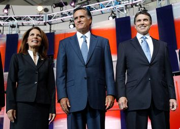 U.S. Republican presidential candidate, Rep. Michele Bachmann (R-MN), former Massachusetts Governor Mitt Romney (C) and Texas Governor Rick Perry
