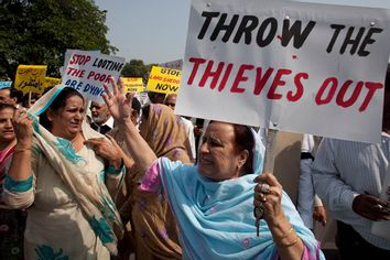 Pakistan's opposition lawmakers rally outside the parliament in Islamabad, Pakistan, Thursday, Oct, 6. 2011
