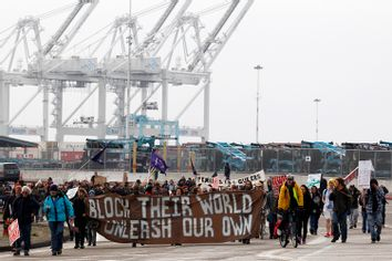 Protestors leave the Port of Oakland after successfully blocking the entrances