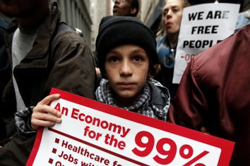 An Occupy Wall Street demonstrator holds a sign during what protest organizers call a