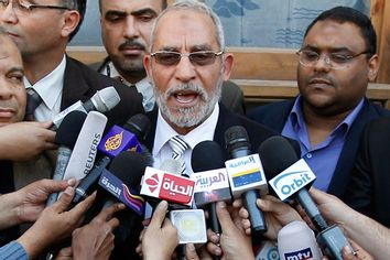 Muslim Brotherhood leader Mohammed Badie speaks to the media after