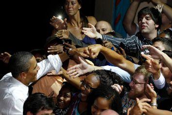 U.S. President Barack Obama fist bumps a supporter