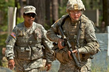 Esasha LeBlanc, left, an Army drill sergeant at Fort Jackson, S.C., works with Pvt. Daniel Ladd, 17, of Darlington, S.C.