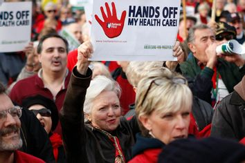 Demonstrators protest against the healthcare bill outside the Capitol in Washington December 15, 2009.