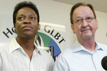 Tyron Garner (L) and John Lawrence (R) appear at a press conference in Houston on June 26, 2003