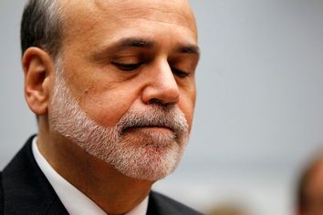 Ben Bernanke reacts as he testifies before the House Committee on the Financial Services semi-annual monetary policy report on Capitol Hill in Washington