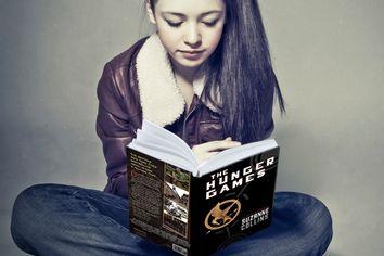 teen girl reads a book