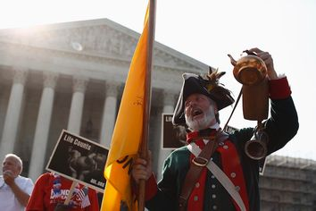 Tea party supporter Temple shouts against the health care overhaul outside the Supreme Court in Washington