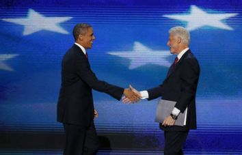 President Barack Obama joins former President Bill Clinton onstage after Clinton nominated Obama for re-election during the second session of the Democratic National Convention in Charlotte