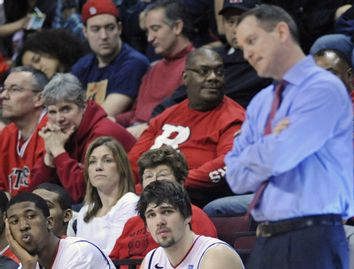 Rutgers players Jack and Biruta look on as Rutgers coach Mike Rice paces in Piscataway