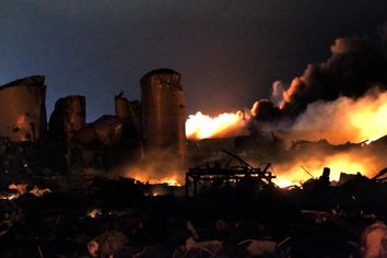The remains of a fertilizer plant burn after an explosion at the plant in the town of West, near Waco, Texas