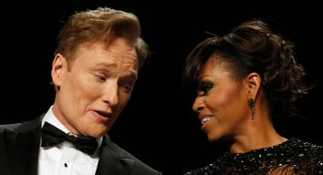 Comedian O'Brien talks to U.S. first lady Obama during the White House Correspondents Association Dinner in Washington