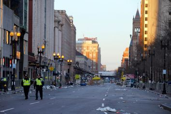 Two police officers walk down Boylston Street, away from the finish line of the Boston Marathon in Boston