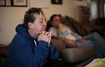 Military veterans sit in the therapy room at New Directions women's house in Los Angeles