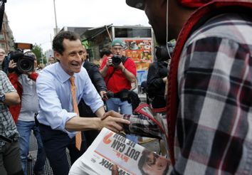Former U.S. Congressman and New York City mayoral candidate Anthony Weiner greets commuters during a campaign event in New York