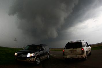 Storm chasers get close to a tornadic thunderstorm, one of several tornadoes that touched down, in South Haven