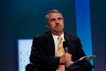 Journalist Thomas Friedman moderates a plenary session on strengthening market-based solutions during the Clinton Global Initiative in New York