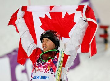 Winner Canada's Bilodeau celebrates after the men's freestyle skiing moguls finals at the 2014 Sochi Winter Olympic Games in Rosa Khutor
