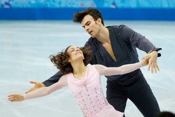 Meagan Duhamel and Eric Radford of Canada compete during the Team Pairs Short Program at the Sochi 2014 Winter Olympics
