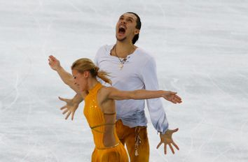 Russia's Tatiana Volosozhar and Maxim Trankov celebrate during the Figure Skating Pairs Free Skating Program at the Sochi 2014 Winter Olympics