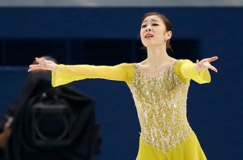 Korea's Yuna Kim finishes her program during the Figure Skating Women's Short Program at the Sochi 2014 Winter Olympics