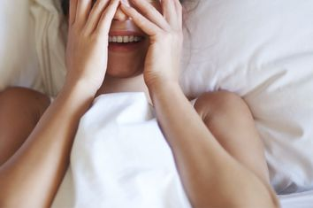 Shy Woman in Bed
