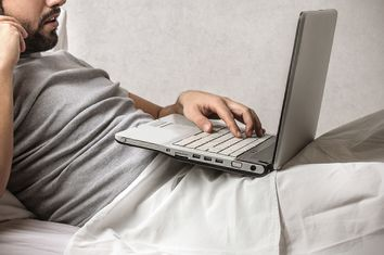 Man in Bed with Computer