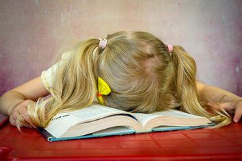 Girl Asleep on Book