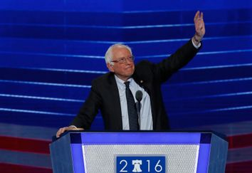 Senator and former Democratic presidential candidate Bernie Sanders waves as he arrives to speak at the Democratic National Convention in Philadelphia