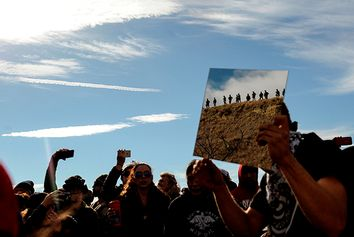 A protester holds up a mirror during a protest of the Dakota Access pipeline on the Standing Rock Indian Reservation near Cannon Ball, North Dakota