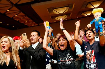Donald Trump supporters cheer as U.S. presidential election results are announced during a Republican watch party in Phoenix