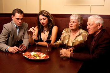 Disinterested couples at dinner