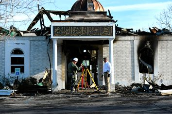 Security officials investigate the aftermath of a fire at the Victoria Islamic Center mosque in Victoria, Texas
