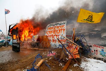 A structure burns after being set alight by protesters preparing to evacuate the main opposition camp against the Dakota Access oil pipeline near Cannon Ball