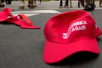 Pro Trump hats lie on the ground
