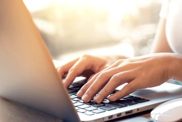 Womans Hand on Laptop
