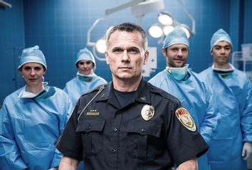 Police In Operating Room