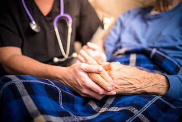 Hospice Nurse and Elderly Patient
