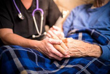 Hospice Nurse and Elderly Patient