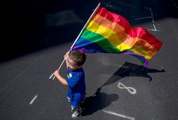 Child with Rainbow Flag