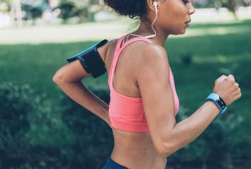 Woman Jogging wearing Technology