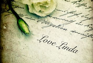 Old handwritten love letter with flowers; Love Linda