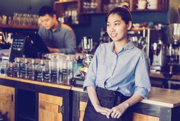Young woman working in coffee house