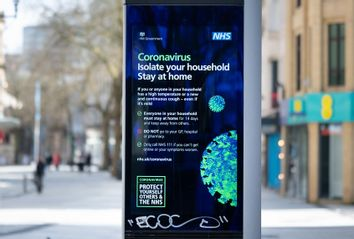 A NHS sign warning of coronavirus on Queen Street