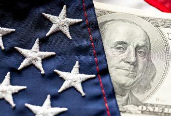 Close-up of Money and U.S. Flag