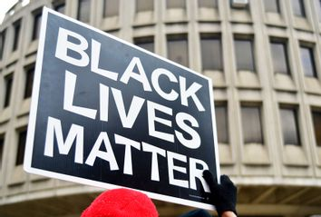 Black Lives Matter sign is held by a protestor