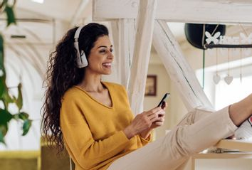 Young woman listening to a podcast