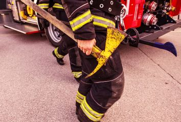 Firefighter holding an axe in his hand
