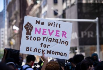 We Will NEVER Stop Fighting for BLACK Women sign