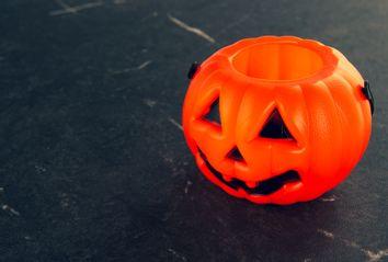 Empty Halloween pumpkin candy bucket